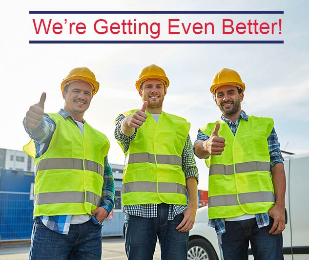 happy male construction workers in high visible vests and hardhats outdoors